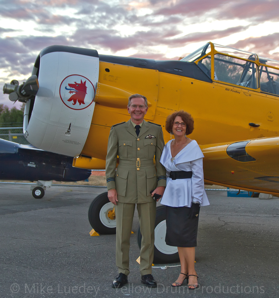 Bill and Eileen Findlay pose for a photo in front of their Harvard