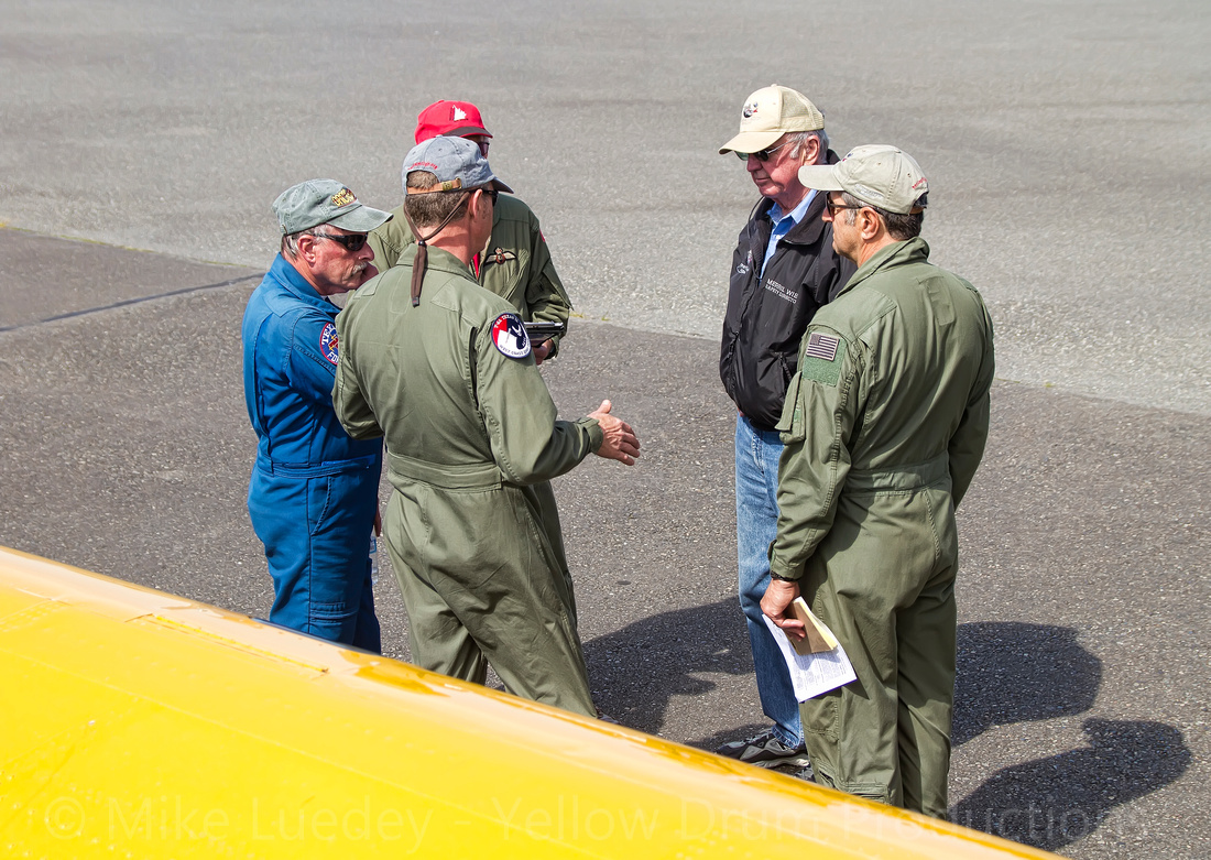 Pilot debrief out by the aircraft